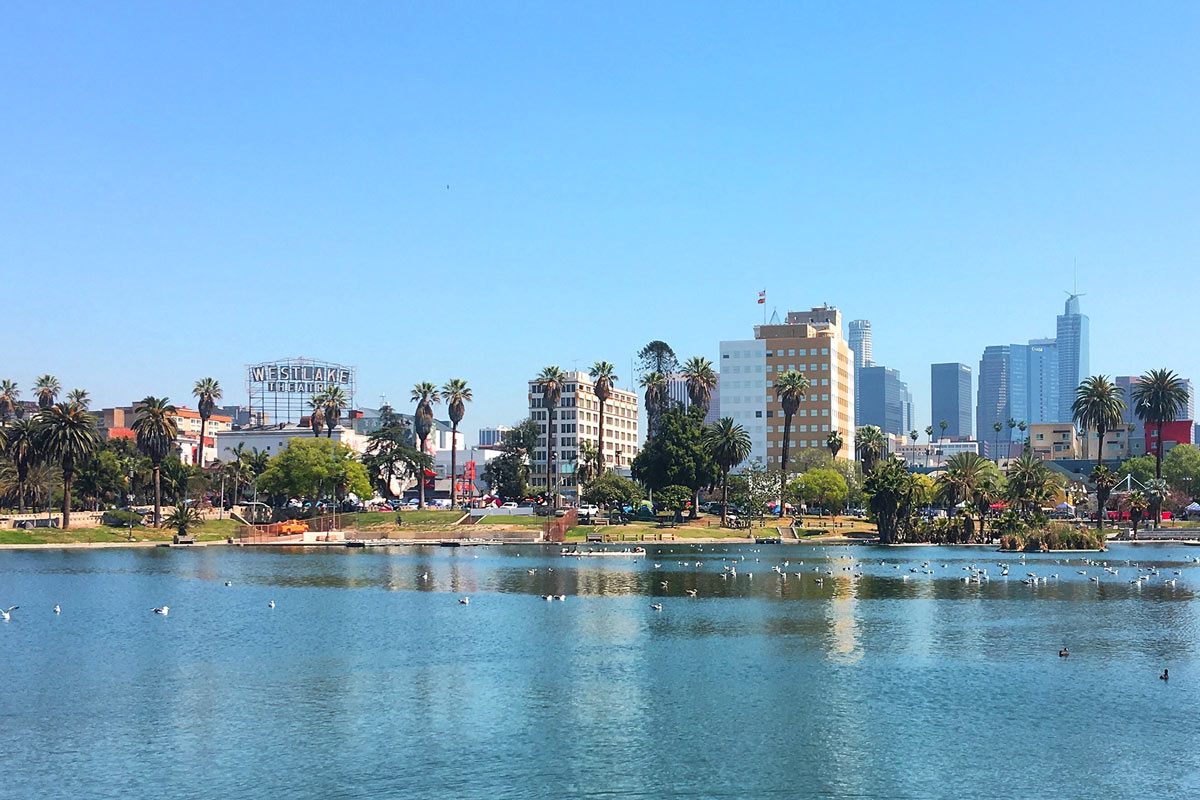 The Los Angeles Skyline wonderfully frames MacArthur Park (formerly Westlake Park) along Angels Walk Wilshire Boulevard.